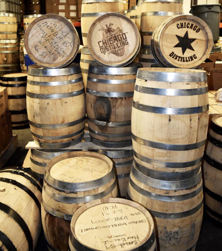 Oak aged whiskey in barrels at Chicago Distilling